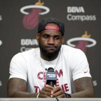 Lie back and relax: LeBron James says he will take a vacation with his family before thinking about where he will play next season. | AP