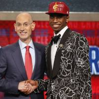Top choice: NBA commissioner Adam Silver congratulates Andrew Wiggins after he was selected by the Cleveland Cavaliers as the No. 1 pick in the 2014 NBA Draft on Thursday in New York.  | AP