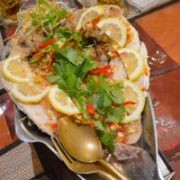 Showpiece: 'Pla neung manao,' a dish of steamed sea bream with lemon and an array of spices, makes an impressive finale to dinner at Baan Suki. | J.J. O'DONOGHUE