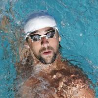Easing into it: Michael Phelps swims during the Santa Clara Grand Prix on Sunday.   AP