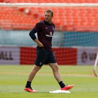 Coming to America: Wayne Rooney walks across the pitch during England's first training session in Miami on Tuesday. | REUTERS