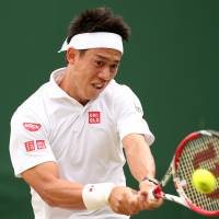Clinical: Kei Nishikori plays a shot from American Dennis Kudla in their second-round match at Wimbledon on Thursday. | AFP-JIJI
