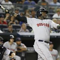 Big Papi: Red Sox slugger David Ortiz hits a three-run homer against the Yankees on Sunday in New York. Boston went on to win 8-5. | AP