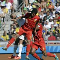 Heat of battle: Belgium's Axel Witsel wins a header during Tuesday's 2-1 win over Algeria.   AP