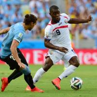 Upset special: Costa Rica's Joel Campbell (right) takes on Uruguay's Martin Caceres in Fortaleza on Saturday. | AFP-JIJI