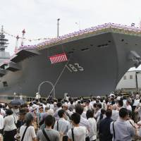 People attend the launch of the Izumo 'flat-topped destroyer' in Yokohama in August 2013.