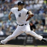 Sizzles again: New York's Masahiro Tanaka throws a pitch against Minnesota during the first inning on Saturday. | AP