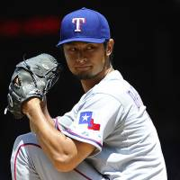 In the groove: Texas' Yu Darvish delivers during the Rangers' 2-0 win over the Nationals on Sunday. | REUTERS/USA TODAY