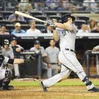 Historic performance: Seattle's Kyle Seager blasts a three-run homer against New York in the ninth inning on Monday. The Mariners routed the Yankees 10-2.   AP