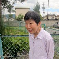 Matsumoto resident Toshie Koibuchi poses for a photograph at the same location earlier this month. | PAUL MURPHY