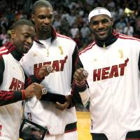 At what cost?: The Heat's Dwyane Wade (left) Chris Bosh (center) and LeBron James have all opted out of their deals. | AP