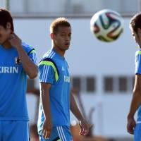 Second chance: Keisuke Honda (center) admitted he was 'shocked' by the manner of Japan's defeat to Cote d'Ivoire in its opening match of the 2014 World Cup. | AFP-JIJI