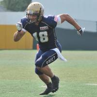 Primary target: Obic's Noriaki Kinoshita scored two touchdowns and had 236 yards receiving on eight catches in Monday's 37-34 victory over Fujitsu in the Pearl Bowl Final. | HIROSHI IKEZAWA