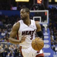 Testing the market: Miami Heat star Dwyane Wade, who has helped the team win three NBA titles, will opt out of his contract and become a free agent.   AP
