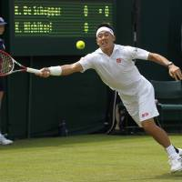 No mistakes: Kei Nishikori plays a shot during his Wimbledon first-round win over Kenny de Schepper on Tuesday. | AP