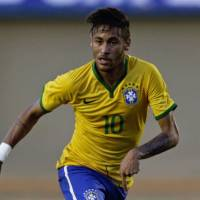 Crowd favorite: The weight of an expectant home nation rests on the shoulders of Brazilian star forward Neymar. | REUTERS