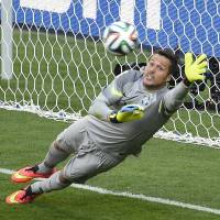 Sublime: Brazil's Julio Cesar makes a save against Chile in the penalty shootout on Saturday in Belo Horizonte. | AFP-JIJI