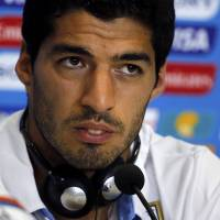Insincere: Uruguay striker Luis Suarez was suspended for four months by FIFA for biting Italy's Giorgio Chiellini in a first-round match on Tuesday. | REUTERS