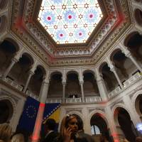 Tourists examine the interior of the newly re-opened National Library in Sarajevo in May. | AP