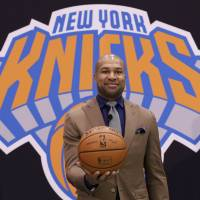 First time for everything: New Knicks head coach Derek Fisher poses at a news conference on Tuesday. | AP