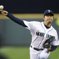 Looking for support: Seattle starting pitcher Hisashi Iwakuma delivers during the Mariners' 3-2 loss to the Yankees on Tuesday. | AP