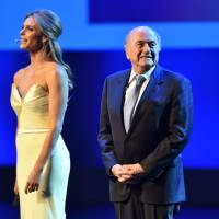 Grin and bear it: FIFA president Sepp Blatter stands on stage during the opening ceremony of the FIFA Congress in Sao Paulo on Tuesday. | AFP-JIJI