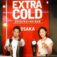 Drink up: Figure skater Daisuke Takahashi and skier Aiko Uemura promote Asahi's Extra Cold beer at a media event in Osaka last month. | KYODO