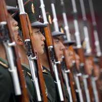 China claims its military buildup is solely for defending its own sovereignty.   BLOOMBERG