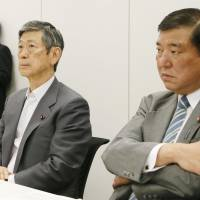 Liberal Democratic Party Vice President Masahiko Komura (second from right) and Kazuo Kitagawa (second from left), his counterpart in New Komeito, attend a meeting on security policy Tuesday in Tokyo. | KYODO