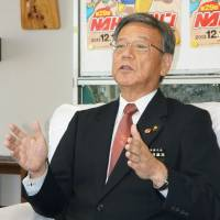 Naha Mayor Takeshi Onaga holds a news conference at his office in the capital of Okinawa last November. | KYODO