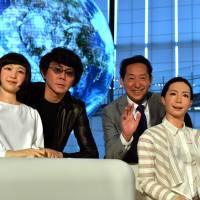 Mamoru Mori (second from right), a former astronaut and the director of the National Museum of Emerging Science and Technology (Miraikan) and Hiroshi Ishiguro (second from left), a professor at Osaka University, pose with humanoid robots Otonaroid (right) and Kodomoroid (left) at the museum on Tuesday.   AFP-JIJI
