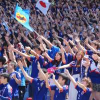 Thousands of soccer fans cheer for Japan on Sunday morning in Nissan Stadium in Yokohama, one of the many public sites where they could watch the team play Cote d'Ivoire during the World Cup in Brazil. Japan lost 2-1. | KAZUAKI NAGATA