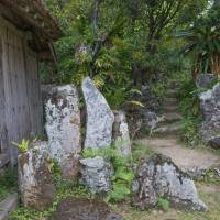 Tranquil retreat: Seasoned wood and weathered stone create sense of antiquity at Miyara Dunchi, a traditional garden in Okinawa that has survived nearly 200 years of history. | STEPHEN MANSFIELD