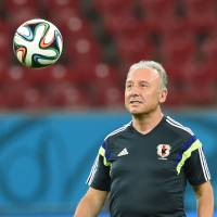 No more talking: Japan manager Alberto Zaccheroni kicks a ball during a training session on Friday in Recife, Brazil. | AP