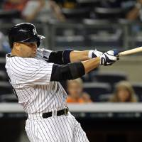 Touch 'em all: The Yankees' Carlos Beltran hits a walk-off three-run home run in the ninth inning against the Orioles on Friday night in New York. The Yankees defeated Baltimore 5-3.   REUTERS