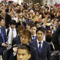 We're back: The Samurai Blue arrive at Narita on Friday. | KYODO