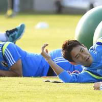 Final fight: Shinji Kagawa (right) and Yoichiro Kakitani (left) take part in a training session at Japan's World Cup base in Itu, Brazil on Friday. | KYODO