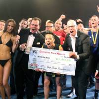 Executives cheer as they present a ¥5.8 million check for kids with cancer after a boxing event in Tokyo on May 23. | KYODO