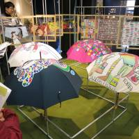Umbrellas and other products featuring designs by disabled artists are displayed during an exhibition at the Shibuya Hikarie shopping mall in Tokyo on Nov. 29, 2013.   KYODO