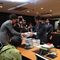 Yuya Kamoshita, who fled Iwaki, Fukushima Prefecture, submits a petition to the Cabinet Office on April 25, demanding help tailored to the needs of nuclear evacuees. It was signed by 16,000 fellow evacuees.   HINAN SEIKATSU O MAMORU KAI