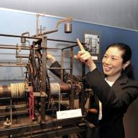 "A guide at the Seiko Museum in Sumida Ward, Tokyo, talks about a weight-driven ""iron movement tower'' clock from Europe that dates back to around 1500, on May 21. 