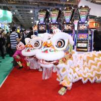 Chinese lion mascots and slot machines brighten up last month's G2E Asia Expo in Macau.G2E Asia Expo