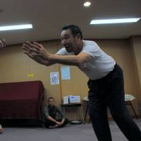 Masato Yokouchi, 51 (left) and Matsuyoshi Koiso, 65, perform an improvised dance during a practice session at the studio. | SATOKO KAWASAKI
