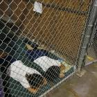 Two female detainees sleep in a holding cell at the U.S. Customs and Border Protection Nogales Placement Center in Arizona on Wednesday.