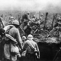 French soldiers attack from a trench during the Battle of Verdun, in eastern France, during World War I. The battle, won by the French in November 1916, eventually cost the lives of 163,000 French soldiers and 143,000 German troops. | AFP-JIJI