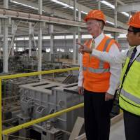 Gov. Bentley and Golden Dragon U.S.A. President Roger Zhang tour the Golden Dragon copper tubing plant being built in Pine Hill, Alabama, last Aug. 29, in a photo provided by the governor's office. | AP