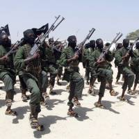 Newly trained al-Shabab fighters perform military exercises south of the Somali capital, Mogadishu, in February 2011. AP