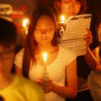 Tens of thousands of people attend a candlelight vigil at Victoria Park in Hong Kong on Wednesday to commemorate the 25th anniversary of the Chinese military crackdown on the pro-democracy movement in Tiananmen Square. | AP