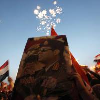 Supporters of former Egyptian Army chief Abdel-Fattah el-Sissi celebrate his poll victory at a rally in Cairo's Tahrir Square. | REUTERS