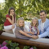 Spanish Crown Prince Felipe, his wife, Princess Letizia, and their daughters Sofia (second left) and Leonor pose for a photo at their official residence in Madrid in August 2012. | AFP-JIJI